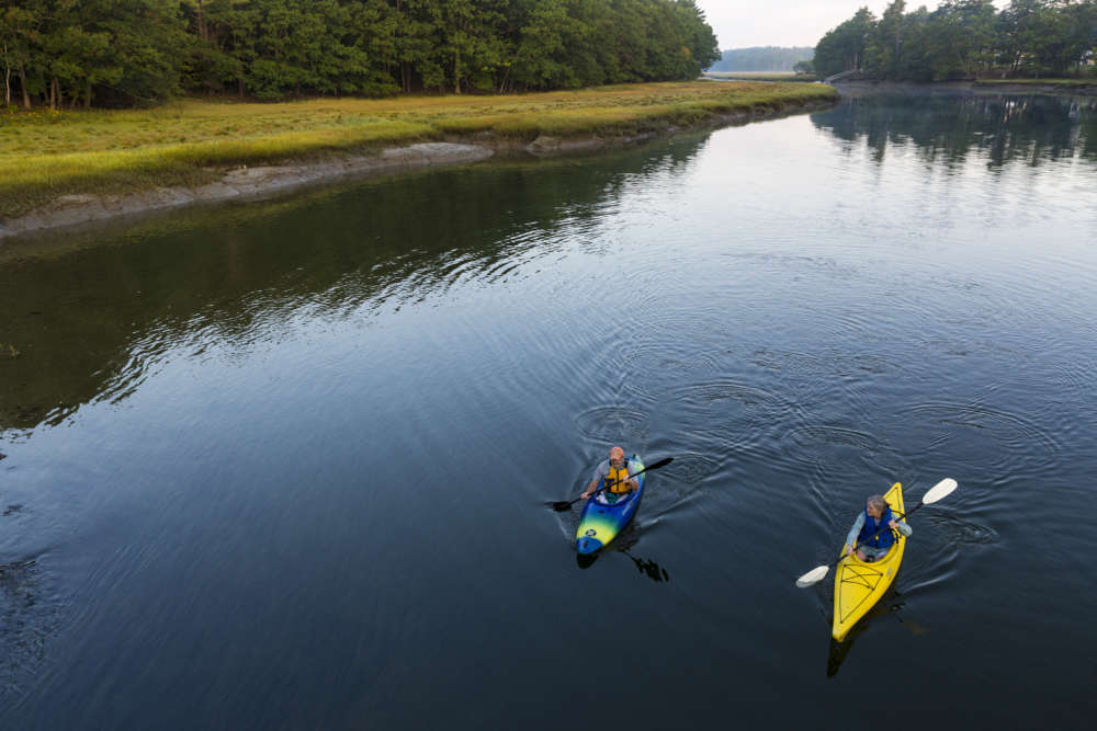 Kayakers paddle the York River. Photo © Jerry Monkman