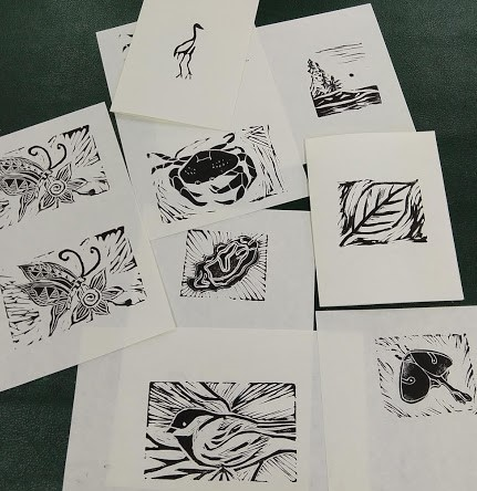 Samples of block print art created during the Hog Island Educator's Week.