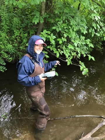 Brianna DeGone working in the Kennebunk River.
