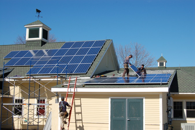 Solar panel installation in progress on Maine Coastal Ecology Center in March 2013