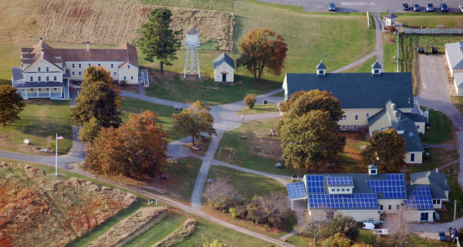 Aerial view of Wells Reserve Laudholm campus with Maine Coastal Ecology Center photovoltaic installation visible in lower right