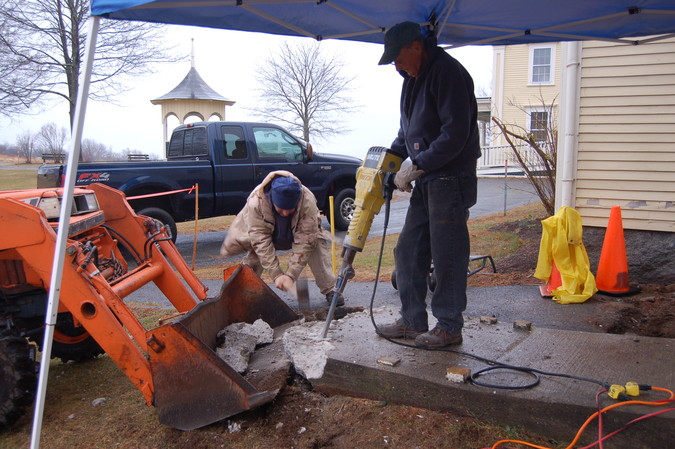 Frank and John, with jackhammer and sledge, team up to break up the obsolete concrete ramp.
