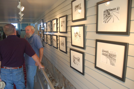 Artist George Burk and his brush and ink paintings