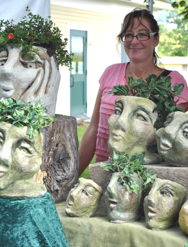 Valerie McCaffrey poses with a number of her garden guardians
