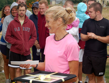 Christine Reaser, first place woman in the 2010 Laudholm 5K, accepts her prize