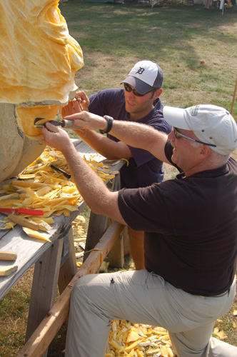 Mr. Auger and assistant working on the giant pumpkin