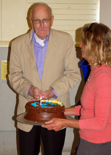 Dick Eaton accepts a birthday cake from Nancy Viehmann