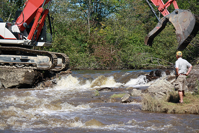 Steve Heinz of the Sebago Chapter of Trout Unlimited stands on the bank of a free-flowing Goff Mill Brook in Arundel as the final remnants of a small dam are removed.