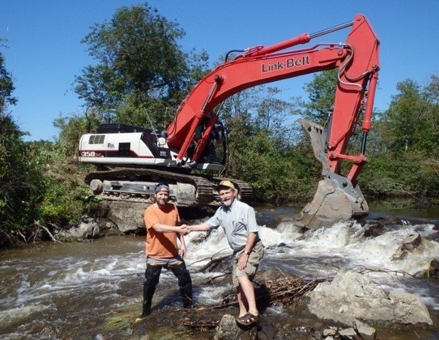 Jake Aman of the Wells Reserve and Steve Heinz of the Sebago Chapter of Trout Unlimited celebrate the removal of a dam from Goff Mill Brook in Arundel.