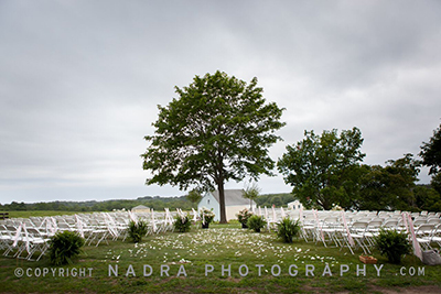 Wedding chairs overlook fields. Photo © Nadra Photography.